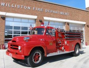 The Williston Fire Department will park this antique fire truck on the town green on July 3 and 4 to collect donations for the Williston Community Food Shelf.