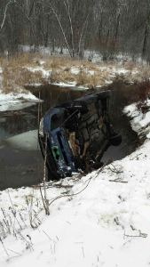 Observer courtesy photo A driver and her dog were trapped in a vehicle after it rolled on Beebe Lane on Jan 3.  EMTs helped free the women and dog, and the driver was transported to the hospital.