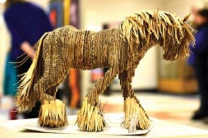 Observer photo by Al Frey Senior Lanie Beaudin's cardboard horse sculpture stands at about 9 inches high. Teacher Tim Duvernoy chose the medium—in this case, cardboard—and it was up to the student to select the subject. Duvernoy estimates that it took Beaudin 10 hours to complete.