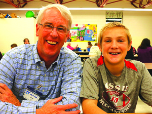 Eight-year CY mentor Andy Mikell sits with his mentee, Williston Central School eighth grader Andrew Beatty.