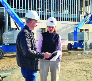 Observer photo by Jess Wisloski Project manager Bob Bickford of Wright & Morrissey (left) consults with Sharon Gutwin. She sees her new facility, Kismet, as perfectly positioned to provide therapeutic exercise to those who need it as medical treatment.