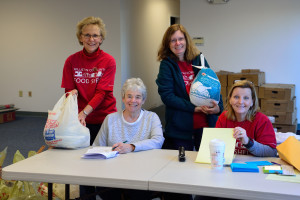 Williston Community Food Shelf volunteers (L to R) Ginger Morton, Jean Staunton, Jen Daudelin and Jennifer Selwah keep the turkey table well organized during the WCFS Turkey Day Giveaway on Saturday the 19th.
