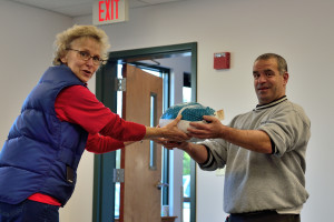 A grateful Richard Olio receives his turkey from volunteer, Ginger Morton  during the Williston Community Food Shelf Turkey Day Giveaway on Saturday the 19th. Turkeys were donated by members of the Williston Community.