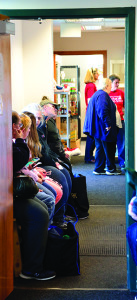 Folks patiently wait in line at the Williston Community Food Shelf during the WCFS Turkey Day Giveaway on Saturday the 19th.