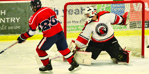 CVU goalie, Ty Parker, foils a scoring chance by Lower Canada College on Friday night at Cairns Arena in South Burlington.