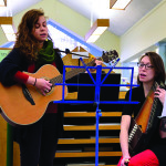 Marcie Hernandez (L) and Flora Whitmore (R) provide music during the Dorothy Alling Library Holiday Party on Saturday, December 3rd.