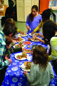 A whole community of gingerbread houses are under constructiion during the Dorothy Alling Library Holiday Party on Saturday, December 3rd