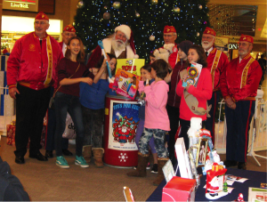 Observer courtesy photo On Dec. 9, Girl Scout Troup #30308 of Essex Jct. shopped and delivered donated  'Toys for Kids'. Representatives from the Marine Corps League (Donald G. Cook Detachment) thanked the troop for its toy donations.