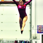 Observer courtesy photos (RIGHT) Julia Higa performs a beam routine in December, 2015 and practices this fall.