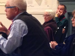 L to R: Gary Hawley, a town conservation committee member, speaks in support of the Catamount purchase as Lucy and Jim McCullough, the owners, listen on Jan. 3.  Photo by Jess Wisloski/Williston Observer