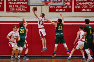 CVU's, Walker Storey outleaps BBA's William Frank for the rebound during the CVU boys first round game versus Burr & Burton Academy at the Kevin Riell Memorial Tournament held at CVU on 30Dec16.