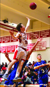 Josh Bliss gets fouled on his way to the rack during CVU's game versus Colchester on Thursday, January 12.