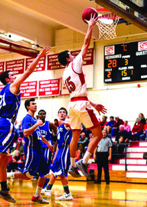 Colin Monsey gets an easy basket CVU's game versus Colchester on Thursday, January 12.