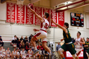 Paul Keen stretches for the basket during the CVU boys first round game versus Burr & Burton Academy at the Kevin Riell Memorial Tournament held at CVU on 30Dec16.