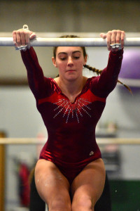 CVU's Lexi Cody begins her uneven parallel bar routine during the gymnastics meet in Williston with competitors from CVU, Middlebury and Montpelier on 21Dec16.