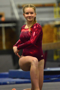 CVU's Tali Guibardo smiles for the judge during her floor exercise at the gymnastics meet in Williston with competitors from CVU, Middlebury and Montpelier on 21Dec16.