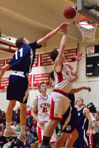 CVU's Reece Pawlaczyk drives for a layup against the block of MMU's Tyler Muttilainen during their game on 20Dec16 at CVU,