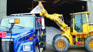 Observer file photo A front loader purs road salt into a municipal truck in Williston.