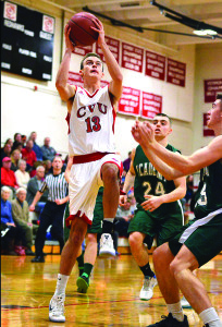 George Davis drives the lane durring CVU's game versus St Johnsbury Academy on Monday the 13th at CVU