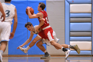George Davis fights for the ball during CVU's game versus So Burlington at SBHS on Thursday the 16th.