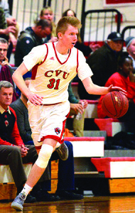 Walker Storey looks to start the fast break durring CVU's game versus St Johnsbury Academy on Monday the 13th at CVU