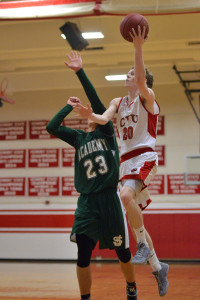Josh Bliss puts in a layup durring CVU's game versus St Johnsbury Academy on Monday the 13th at CVU