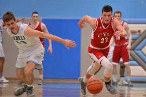 Brad Reynolds beats his opponent to the loose ball during CVU's game versus So Burlington at SBHS on Thursday the 16th.