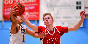 Walker Storey steals the ball away from his So Burlington opponent during CVU's game versus So Burlington at SBHS on Thursday the 16th.