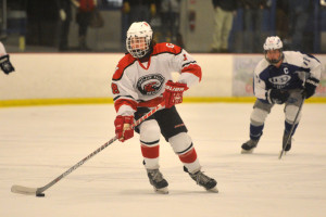 Max Akey looks up to pass during CVU's game versus U-32 on Wednesday night the 1st of February.