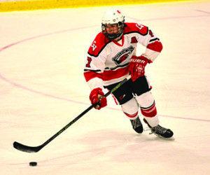 "Richard Hall looks to"" head-man"" the puck during CVU's game versus So Burlington on Saturday the 18th st Cairnes Arena."