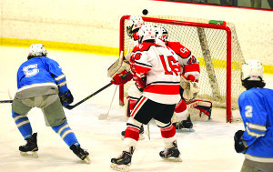 CVU goalie,Ty Parker,  tips the puck over the top of the net during CVU's game versus So Burlington on Saturday the 18th st Cairnes Arena.