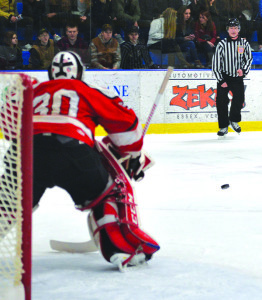 Goalie, Ty Parker squares up to the shooter during CVU's hockey game versus Essex at the Essex skating facility on Saturday the 28th.