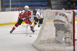 Max Akey cuts to the net during CVU's hockey game versus Essex at the Essex skating facility on Saturday the 28th.