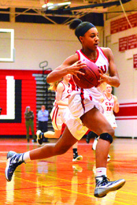 Mekkena Boyd makes her drive to the hoop during CVU's game vs BFA St Albans on Tuesday the 14th at CVU.
