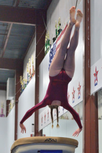 Bella Rieley flies off the vault during CVU's gymnastics meet with Montpelier and Harwood Union on Wednesday the 25th.