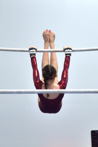 Maddie Searafini works the high bar of her uneven parallel bar routine during CVU's gymnastics meet with Montpelier and Harwood Union on Wednesday the 25th.