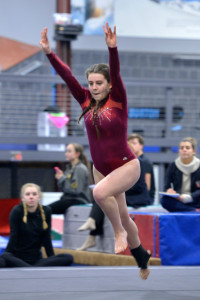 Jam Giubardo begins one of her tumbling runs during her floor exercise routine at CVU's gymnastics meet with Montpelier and Harwood Union on Wednesday the 25th.