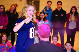 Williston Central School chef Sam Beatson gets his hair sprayed pink as part of his fund raising efforts for Saturday's Peguin Plunge at the Burlington waterfront.
