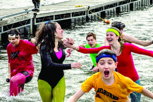 Observer photo by Chris Davis/Special Olympics Students from Williston Central School emerge from Lake Champlain in 2016