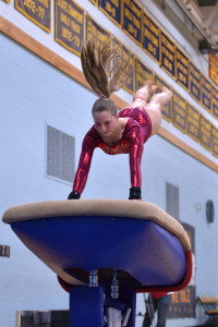 Laurynn Bombardier flies to a third place fiinsh in the vault and 4th place in the over-all competition during the State gymnastics meet at Essex High School on the Saturday the 18th.