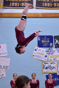 Emma Lieberman makes a high-flying dismount on her way to a 6th place finish in the un-even parallel bars during the State gymnastics meet at Essex High School on the Saturday the 18th.