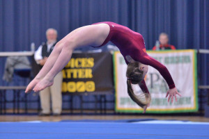 Tali Giubardo shows her tumbling skill on the floor exercise during the State gymnastics meet at Essex High School on the Saturday the 18th.
