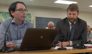 Paul Conner, left, director of planning and zoning for South Burlington, and Andrew Bolduc, city attorney, discuss an affordability covenant that had prevented the sale of three homes to Burlington International Airport. Photo by Emily Greenberg/VTDigger