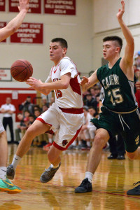 Colin Monsey drives the  lane for two points during CVU's quarter final game with St Johnsbury Academy on March 3rd at CVU.