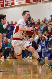 Reece Pawlaczyk makes his move in the paint during CVU's quarter final game with St Johnsbury Academy on March 3rd at CVU.