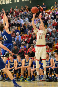 Walker Storey puts up a THREEEEE! during CVU's Semi-final game versus Missisquoi Valley on Tuesday the 7th at UVM's Patrick Gym