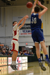 Colin Monsey puts up a long jumper during CVU's Semi-final game versus Missisquoi Valley on Tuesday the 7th at UVM's Patrick Gym