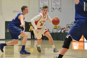 Paul Keen looks to drive the lane during CVU's Semi-final game versus Missisquoi Valley on Tuesday the 7th at UVM's Patrick Gym