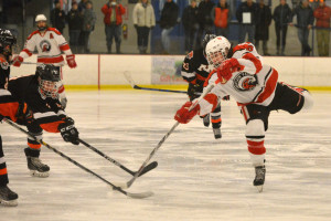 Max Akey gets off a shot on goal during CVU's quarterfinal game with Middlebury on March 4th at Cairns Arena.