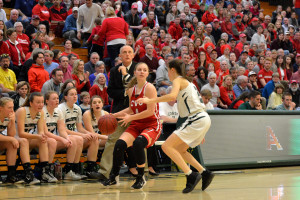 Senior, Jaime Vachon looks to pass after bringing the ball up court during CVU's Division 1 Girls Basketball Championship game versus St. Johnsbury Academy on Saturday the 18th. CVU won it's fifth consecutive girls title.